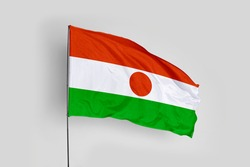 Niger flag isolated on white background with clipping path. close up waving flag of Niger. flag symbols of Niger.