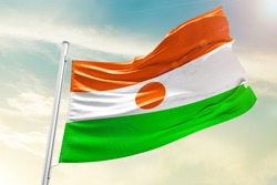 Niger national flag cloth fabric waving on the sky  - Image