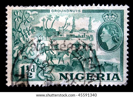 NIGERIA - CIRCA 1940s: A stamp printed in the Nigeria shows cultivation and sale of groundnuts, circa 1940s