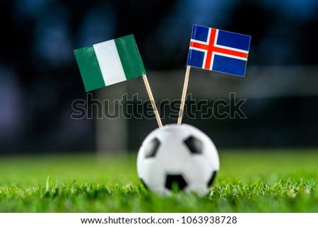Nigeria - Iceland, Group D, Friday, 22. June, Football, World Cup, Russia 2018, National Flags on green grass, white football ball on ground. #1063938728