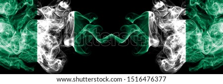 Nigeria vs Nigeria, Nigerian abstract smoky mystic flags placed side by side. Thick colored silky smoke flags of Nigerian and Nigeria, Nigerian #1516476377