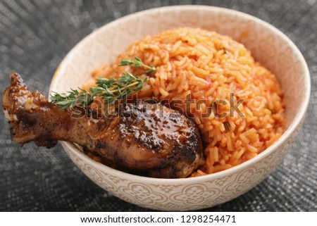 Nigerian Jollof Rice with roasted chicken thigh and thyme