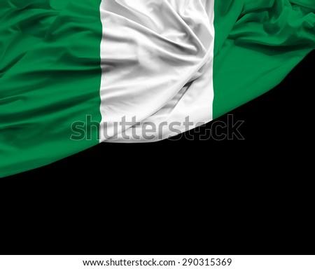 Nigerian waving flag on black background