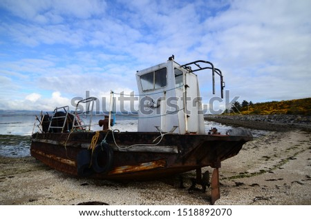 Nigg bay shipwreck or just forgotten about stranded on the beach north east Scotland ropes rust and hopes washed up