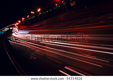 Nigh highway. Cars headlights in motion blur. Long exposure shot. Moscow, Russia - MKAD. Tilt view.