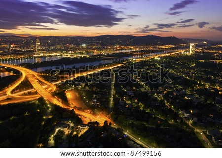 Night above Vienna with Danube River & Island (Donauinsel) and highway junction.