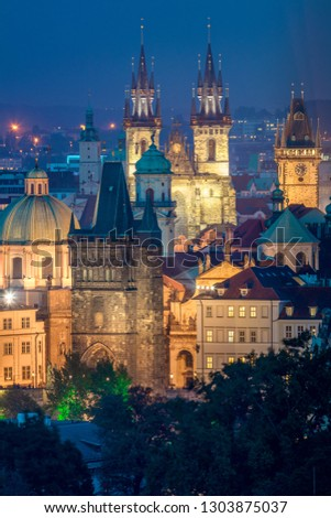 Night aerial view of Prague roofs, castles and churches domes, Czech, Europe
