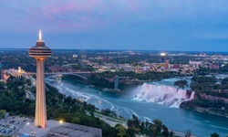 Night aerial view of the Skylon Tower and the beautiful Niagara Falls at Canada
