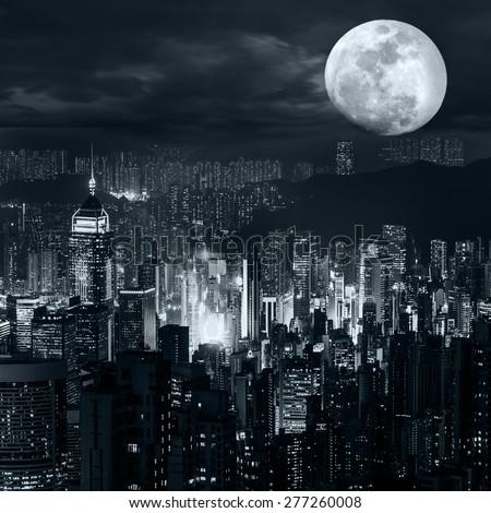 Stock Photo Night aerial view panorama of Hong Kong skyline at full moon night under dramatic cloudy sky