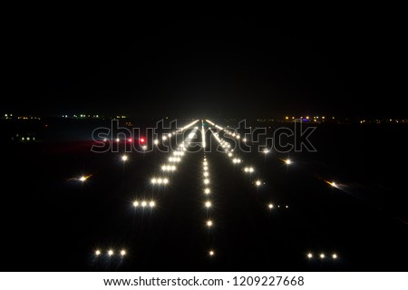 Night airport runway. Runway lights and PAPI-lights.