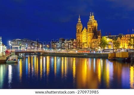 Night Amsterdam canal and Basilica Saint Nichola