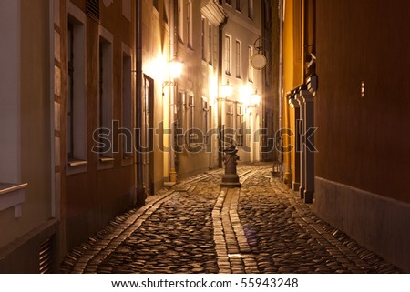 Night at narrow street in capital of Latvia - Riga