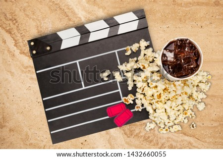 Night at the Movies concept, film clipboard and fresh popcorn
