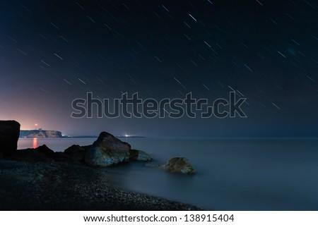 Night beach and star trails