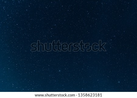 Night blue sky with stars. The texture of a blue sky with stars.