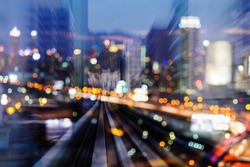 Night blurred bokeh city light and motion blurred train moving, abstract background