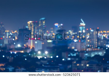 Night blurred bokeh light city office building, abstract background