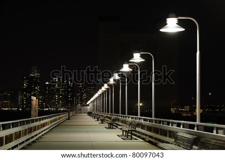 Night bridge with lanterns and bench in Night New York