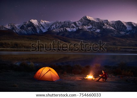 night camping. man tourists...
