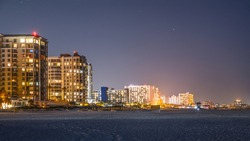 Night City. Island Clearwater Beach FL. Ocean or Gulf of Mexico shore. Spring break or Summer vacations in Florida. Hotels, restaurants and Resorts. Tropical Nature. United States of America.