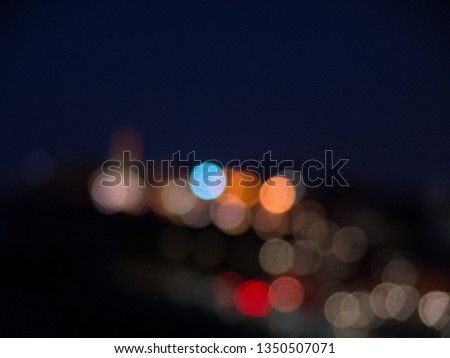 Night city lights bokeh of defocused vivid colorful circles of light in blue hour background in Jaffa, Israel #1350507071