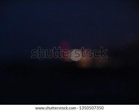 Night city lights bokeh of defocused vivid colorful circles of light in blue hour background in Jaffa, Israel #1350507350