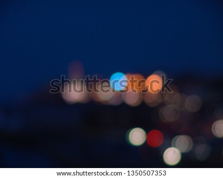 Night city lights bokeh of defocused vivid colorful circles of light in blue hour background in Jaffa, Israel #1350507353