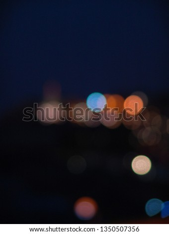 Night city lights bokeh of defocused vivid colorful circles of light in blue hour background in Jaffa, Israel #1350507356