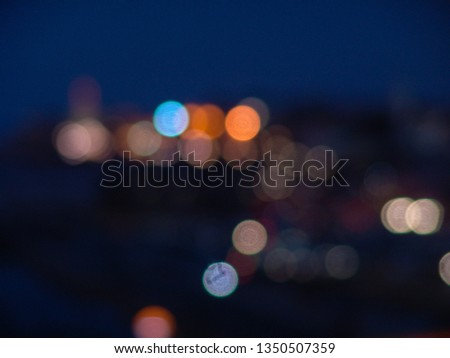 Night city lights bokeh of defocused vivid colorful circles of light in blue hour background in Jaffa, Israel #1350507359