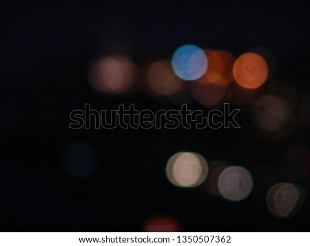 Night city lights bokeh of defocused vivid colorful circles of light in blue hour background in Jaffa, Israel #1350507362