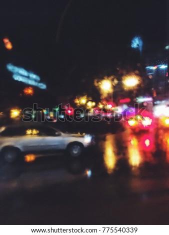 Night city lights, urban traffic lights, blurred mobile photo