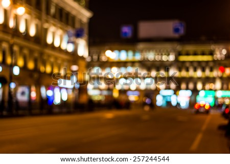Night city, night life on the streets, the buildings in lights in the background