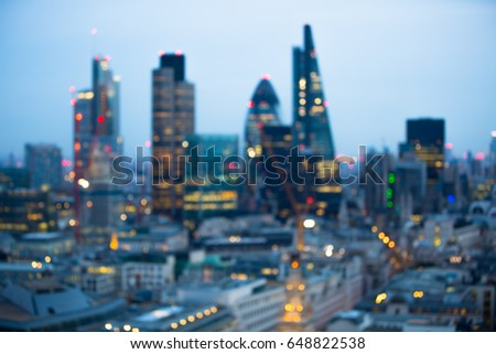 Night city of London view in blur. City street blurry photo, bokeh image. UK