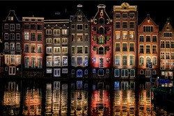 Night city river houses reflection in water. Night lights Holland river city. Town houses reflection in night river water. River houses night lights