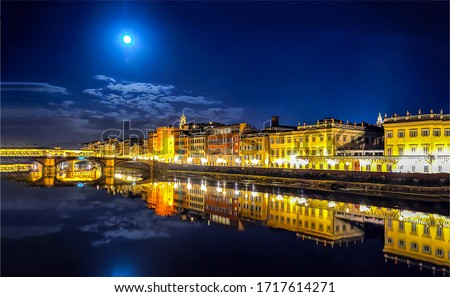 Night city river reflection landscape. River city lights at night. Night river in city lights. Night city river panorama