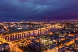 Night city Saint Petersburg from a bird's-eye view. Kantemirovskiy Bridge, drawbridge (bascule bridge)across the Bolshaya Nevka arm of the Neva river. Saint Petersburg Television Tower. Russia.