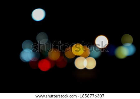 Night city street light bokeh, out of focus, abstract blur background. Selective focus