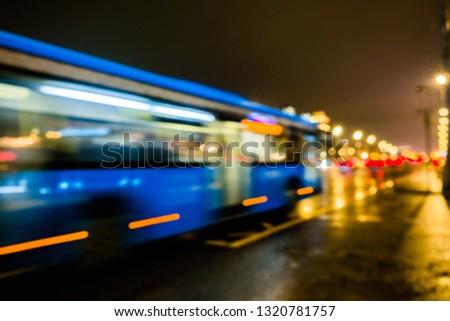 Night city traffic in a giant metropolis.City light bokeh background.Defocused night traffic lights. #1320781757