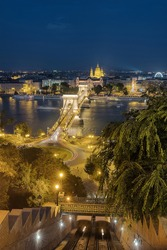 Night cityscape of Budapest with the Chain bridge, St. Stephen's Basilica and castle hill cable car station, Hungary