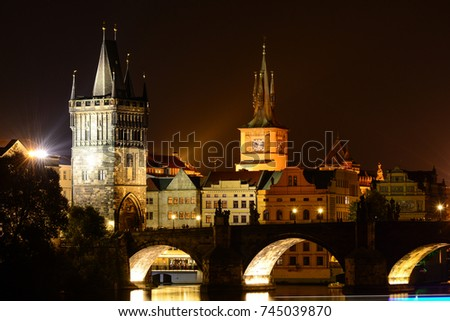 Night cityscape of Prague old town, its towers, Vltava river and Charles bridge #745039870