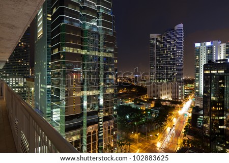 Night cityscape view of the Brickell Avenue area in downtown Miami with office buildings and skyscraper condominiums.