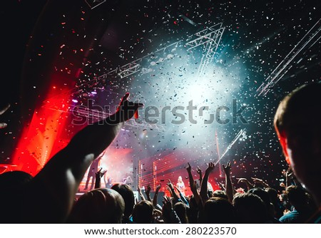 Night club party crowd hands up