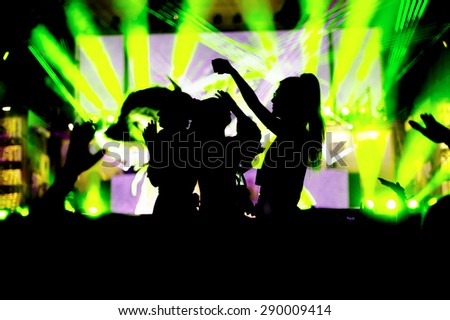 night club party festival crowd hands up dance  with girls silhouettes. green light