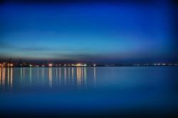 Night coastline, view from the pier of Odessa Sea Port. Ukraine.