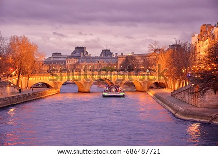 Shutterstock Night cruising on Sena river. Paris, France.