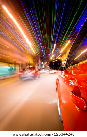 Night driving in city- abstract of motion blur and long exposure building light