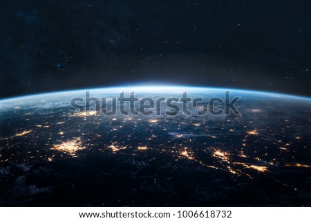 Night Earth. City lights on planet. Civilization. Elements of this image furnished by NASA #1006618732