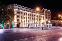 Night empty street in the center of Ufa, Russia with a lighted building with beautiful architecture