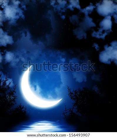 Night fairy tale - bright moon reflected in water