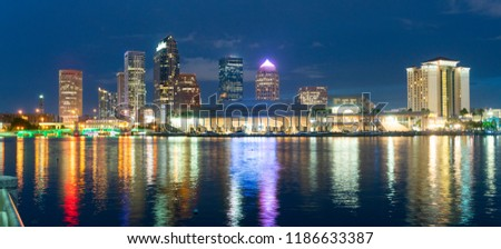 Night falls as lights come up on buildings beginning a beautiful summer evening in Tampa Florida downtown